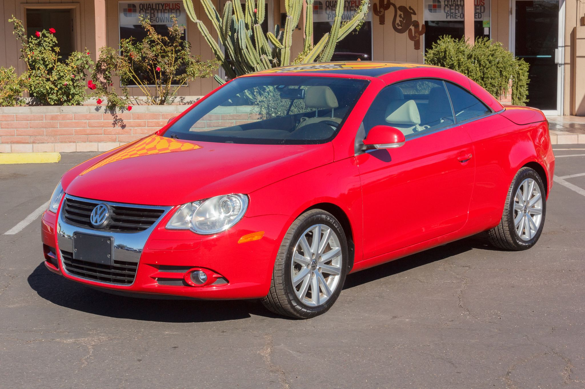 Photo of 2007 Volkswagen Eos 2d Convertible 2.0T Luxury Auto Paprika Red