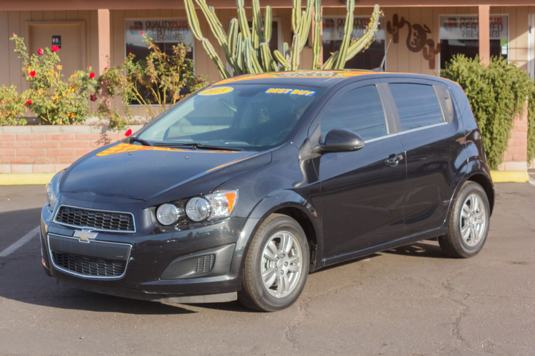 Photo of 2013 Chevrolet Sonic 4d Hatchback LT AT Black Granite Metallic