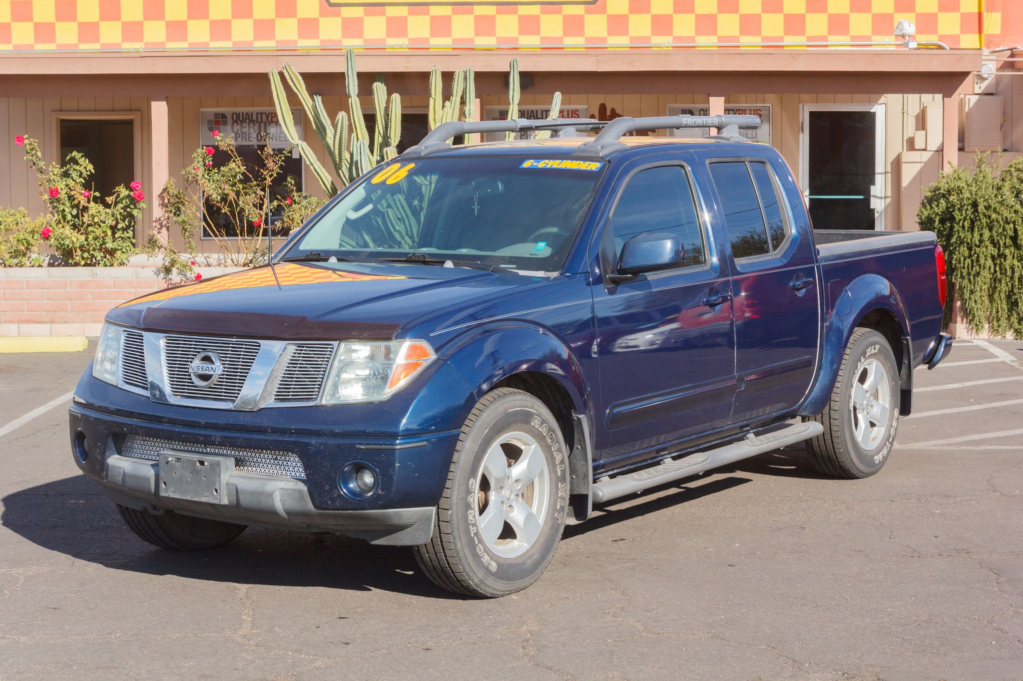 Photo of 2006 Nissan Frontier 2WD Crew Cab LE Majestic Blue