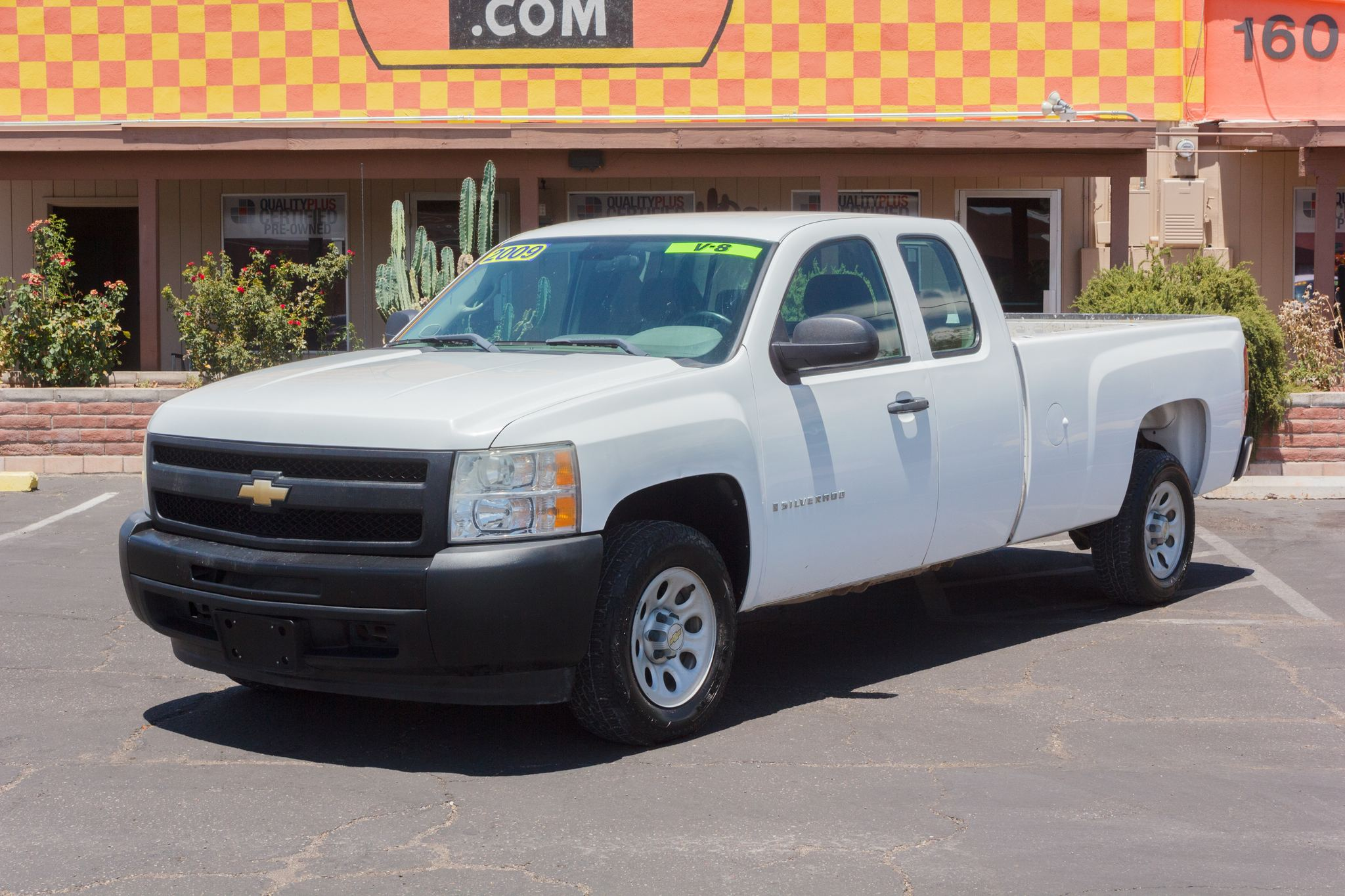 Photo of 2009 Chevrolet Silverado 1500 2WD Ext Cab Work Truck Longbed Summit White