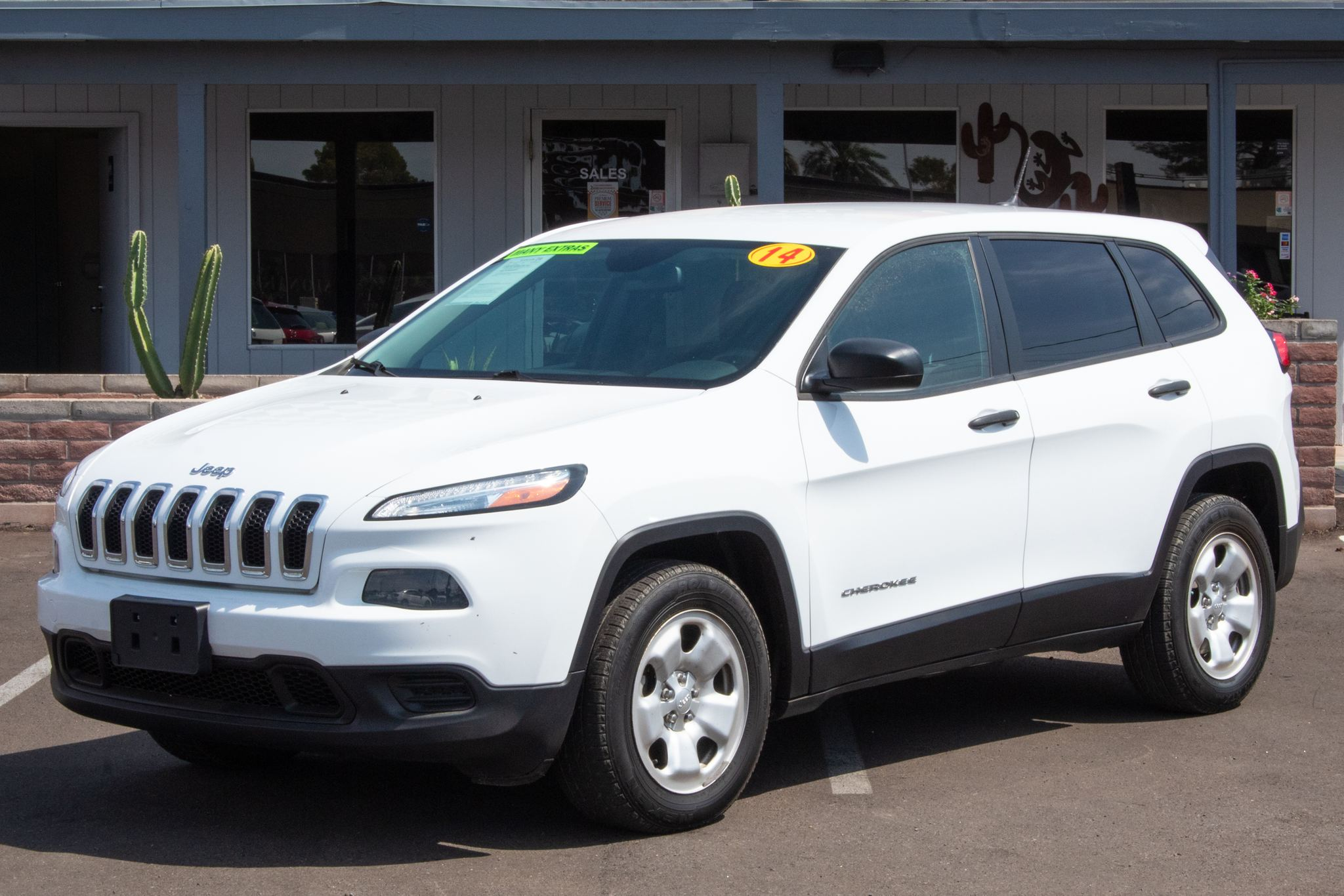 Photo of 2014 Jeep Cherokee 4d SUV 4WD Sport